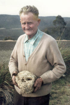 Mr W.F. [Bill] Gilroy Holding Skull